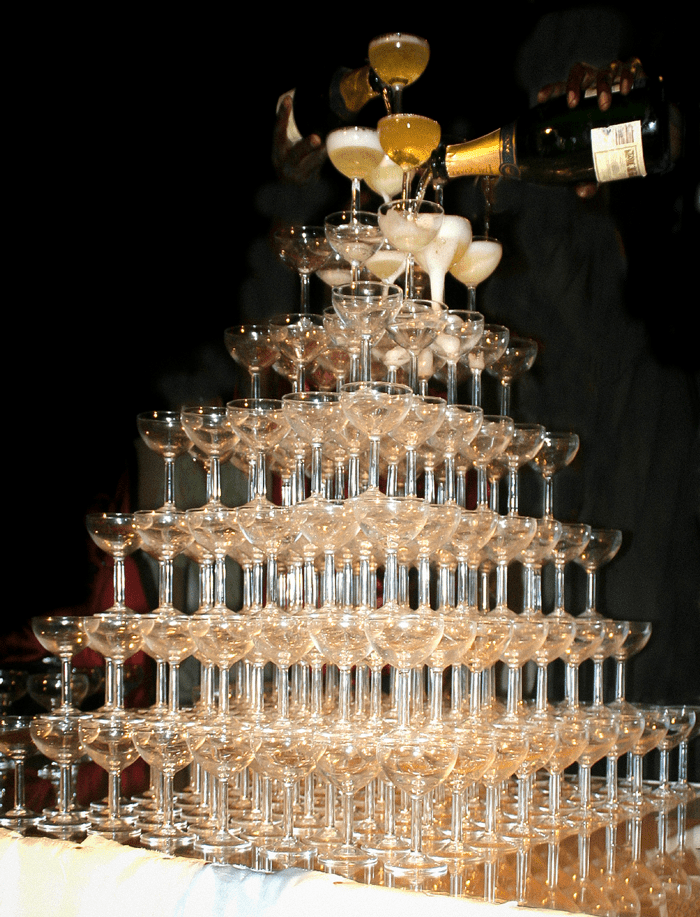 a tower of champagne glasses
